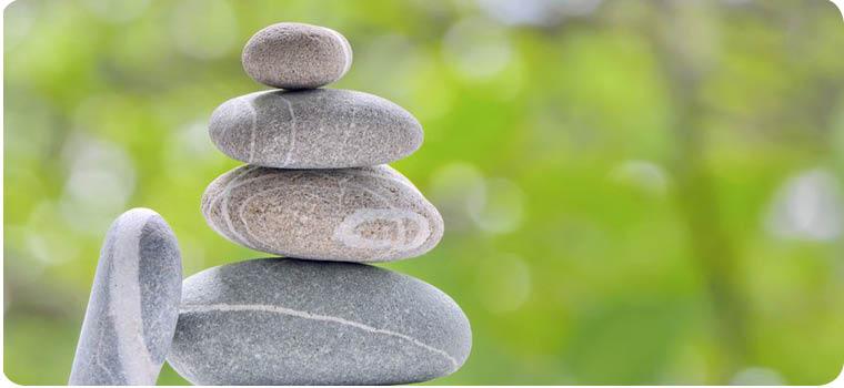 five stones in shape of inukshuk